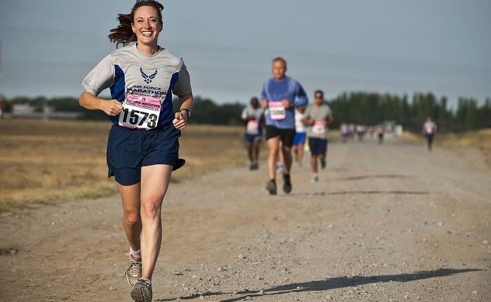 smiling woman running in marathon